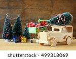 wooden car carrying a christmas ... | Shutterstock . vector #499318069