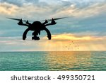 silhouette of a flying drone on ... | Shutterstock . vector #499350721