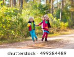 kids playing in autumn park.... | Shutterstock . vector #499384489