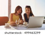 two young successful female... | Shutterstock . vector #499463299