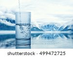 pouring water into a glass... | Shutterstock . vector #499472725