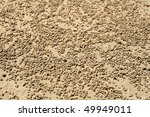 Small photo of many balls of sand made by sand bubbler crab (Dotilla fenestrate) on a Thailand beach