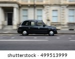 Panning Shot Of A Black Taxi I...