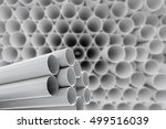 pvc pipes stacked in warehouse. | Shutterstock . vector #499516039