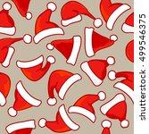 seamless pattern of santa hats. ... | Shutterstock .eps vector #499546375