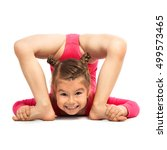 Small photo of Flexible little girl gymnast doing acrobatic feat, isolated on white background. Sport, active lifestyle concept