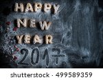 happy new year 2017 cookies on... | Shutterstock . vector #499589359