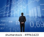 Businessman observing some statistics in front of him - stock photo