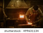 blacksmith with brush handles... | Shutterstock . vector #499631134