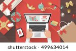 man purchasing christmas gifts... | Shutterstock .eps vector #499634014