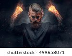 demonic man with burning arms... | Shutterstock . vector #499658071
