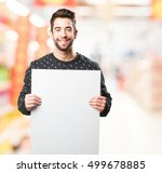 young man holding a banner | Shutterstock . vector #499678885