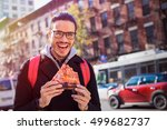 man eating a pizza slice in new ... | Shutterstock . vector #499682737