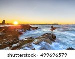 surfer checking out the surf as ... | Shutterstock . vector #499696579