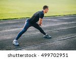 man stretches the body before... | Shutterstock . vector #499702951