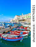 fishing boats in small port... | Shutterstock . vector #499745821