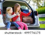 two adorable little sisters... | Shutterstock . vector #499776175
