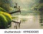 boy fishing at the river | Shutterstock . vector #499830085