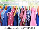 clothes hanging on rack  closeup | Shutterstock . vector #499836481
