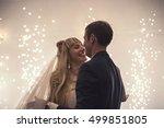 happy bride and groom dancing... | Shutterstock . vector #499851805