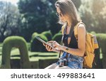 hipster girl with backpack ... | Shutterstock . vector #499883641