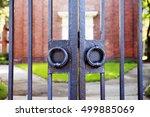 vintage iron gates closeup.... | Shutterstock . vector #499885069