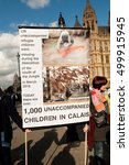 Small photo of London, UK. 15th October 2016. EDITORIAL - Hundreds marched to Downing Street, London, calling on the British government to enact Lord Dubs' amendment now,to relocate 3,000 child refugees into the UK.
