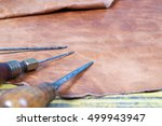 leather craft tools on a wooden ... | Shutterstock . vector #499943947