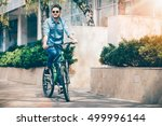 positive smiling guy riding a... | Shutterstock . vector #499996144