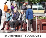 Small photo of SHANGHAI - NOV 4, 2012: Old Chinese people in East Nanjing Road, Shanghai, China. China is facing the aging population problem due to its 36 years one child policy.