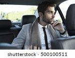 businessman in car  looking away   Shutterstock . vector #500100511