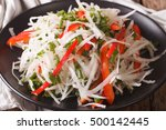 fresh salad of daikon with... | Shutterstock . vector #500142445
