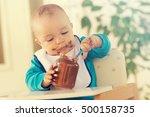 A Baby Grabbing A Jar Of...