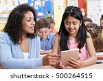 teacher helping group of... | Shutterstock . vector #500264515