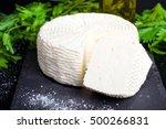 cheese on a dark wooden surface.... | Shutterstock . vector #500266831