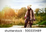 stylish woman hipster cycling.... | Shutterstock . vector #500335489