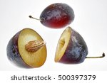 Small photo of whole and halved plums to indemnify.