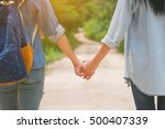 two young girls holding hands ... | Shutterstock . vector #500407339
