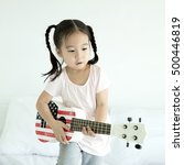 asian little girl plying... | Shutterstock . vector #500446819