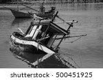 Small photo of traditional fishing boat capsize into the sea .filtered image.selective focus.black and white color process