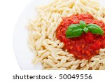 Gemelli Pasta with tomato sauce and fresh basil. - stock photo