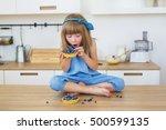 cute little girl in blue dress... | Shutterstock . vector #500599135