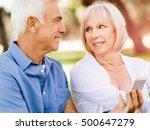 happy senior couple looking at... | Shutterstock . vector #500647279