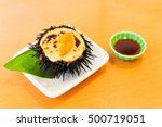 Japanese Uni or Sea Urchin Roe on wood table in famous restaurant of Hakodate, Japan