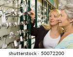 a lady choosing a pair of... | Shutterstock . vector #50072200