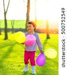 happy girl with balloons outdoor | Shutterstock . vector #500752549