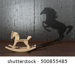 Stock photo the concept of the hidden potencial toy horse in the room which casts a shadow on the wall d 500855485