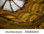 Part of the floors and of the beautiful arch in the famous shopping center Galeries Lafeyette in Paris, capital of France, Europe