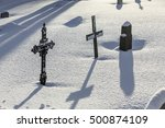 Tombstone Cross And Snow...