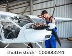 Small photo of Concentrated young aircraftsman repairing small aircraft